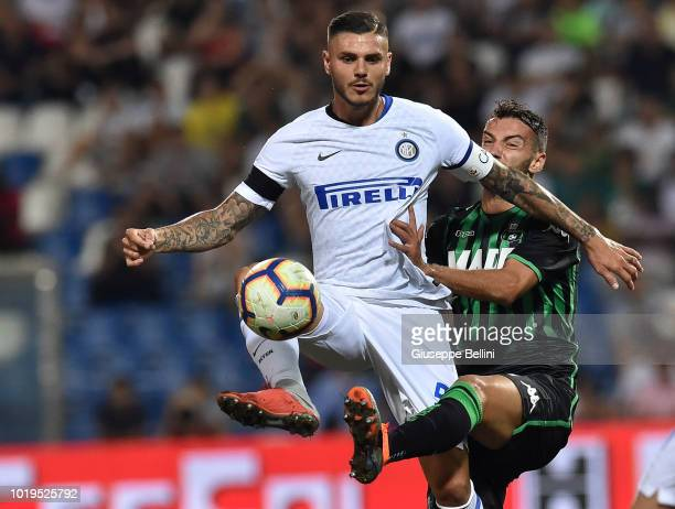 Mauro Icardi of FC Internazionale and Gian Marco Ferrari of US Sassuolo in action during the Serie A match between US Sassuolo and FC Internazionale...