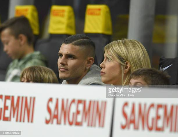 Mauro Icardi of FC Internazionale and his wife Argentine media personality and football agent Wanda Nara attend during the Serie A match between FC...