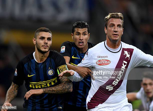 Mauro Icardi of FC Internazionale and Maxi Lopez of FC Torino compete during the Serie A match between FC Internazionale and FC Torino at Stadio...