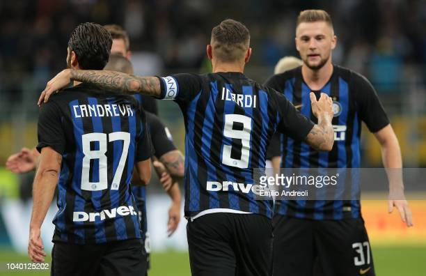 Mauro Icardi of FC Internazionale celebrates with his teammates after scoring the opening goal during the Serie A match between FC Internazionale and...