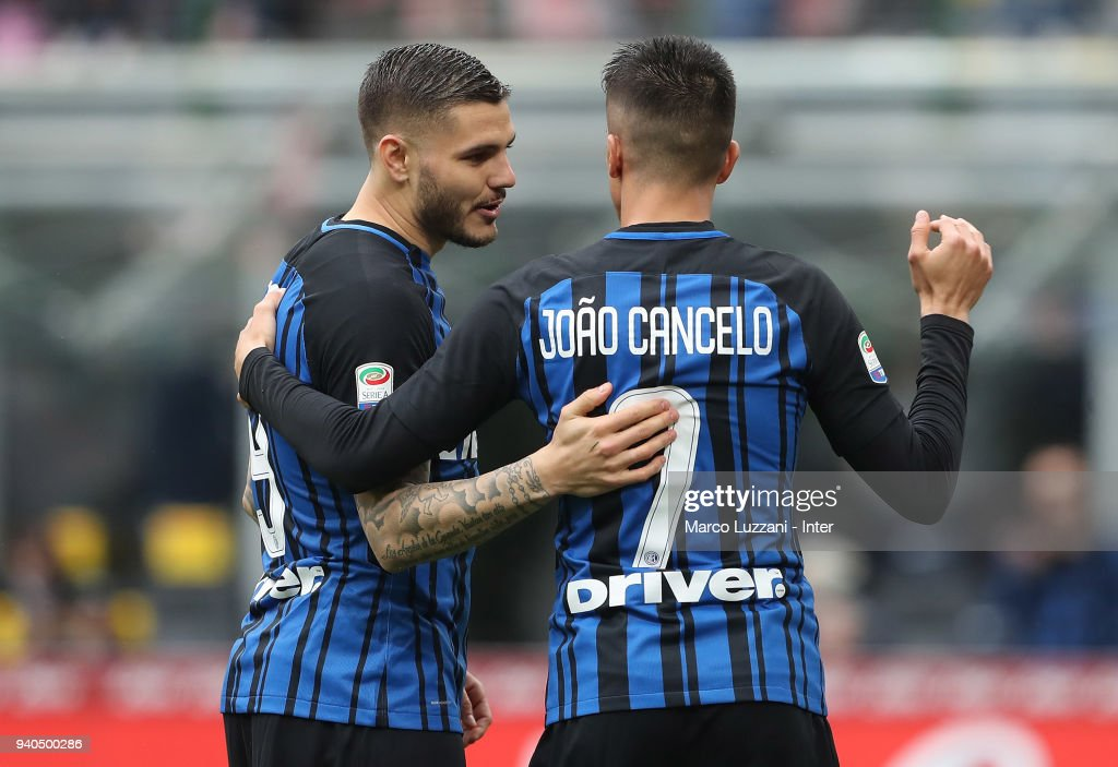 Mauro Icardi of FC Internazionale celebrates with Joao Cancelo after scoring the third goal during the serie A match between FC Internazionale and Hellas Verona FC at Stadio Giuseppe Meazza on March 31, 2018 in Milan, Italy.