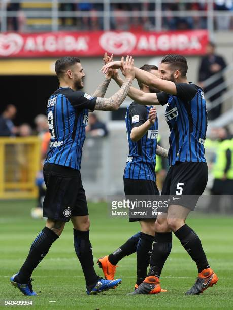 Mauro Icardi of FC Internazionale celebrates with Roberto Gagliardini after scoring the opening goal during the serie A match between FC...