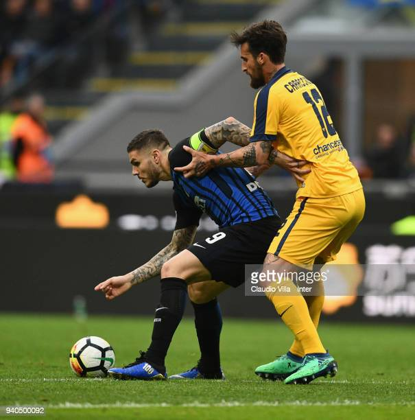 Mauro Icardi of FC Internazionale competes for the ball with Antonio Caracciolo of Hellas Verona FC during the serie A match between FC...