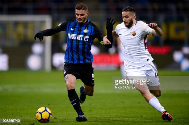 Mauro Icardi of FC Internazionale competes for the ball with Kostas Manolas of AS Roma during the Serie A football match between FC Internazionale...