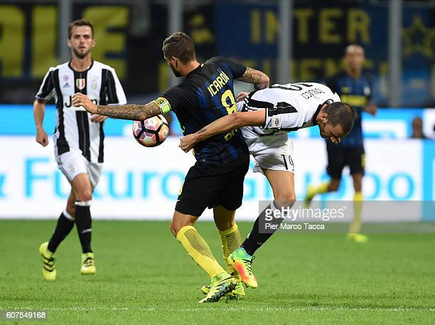 Mauro Icardi of FC Internazionale competes for the ball with Leonardo Bonucci of Juventus FCduring the Serie A match between FC Internazionale and...