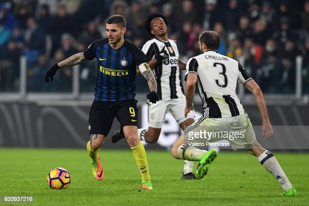 Mauro Icardi of FC Internazionale in action against Giorgio Chiellini of Juventus FC during the Serie A match between Juventus FC and FC...