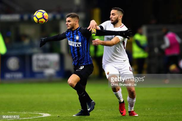 Mauro Icardi of FC Internazionale is challenged by Kostas Manolas of AS Roma during the Serie A match between FC Internazionale and AS Roma at Stadio...