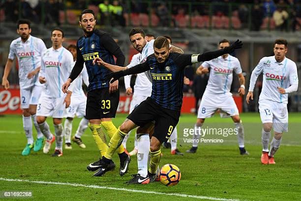Mauro Icardi of FC Internazionale is tackled by Alessandro Gamberini of AC ChievoVerona during the Serie A match between FC Internazionale and AC...
