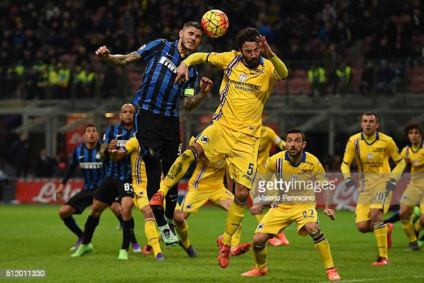 Mauro Icardi of FC Internazionale Milano goes up with Mattia Cassani of UC Sampdoria during the Serie A match between FC Internazionale Milano and UC...