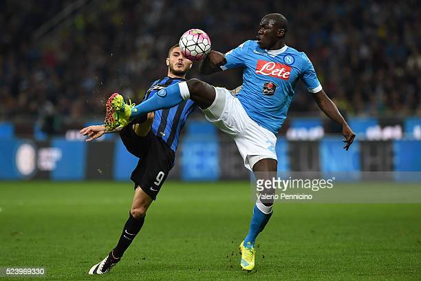Mauro Icardi of FC Internazionale Milano is challenged by Kalidou Koulibaly of SSC Napoli during the Serie A match between FC Internazionale Milano...