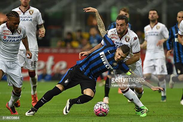 Mauro Icardi of FC Internazionale Milano is tackled by Cristian Molinaro of Torino FC during the Serie A match between FC Internazionale and Torino...