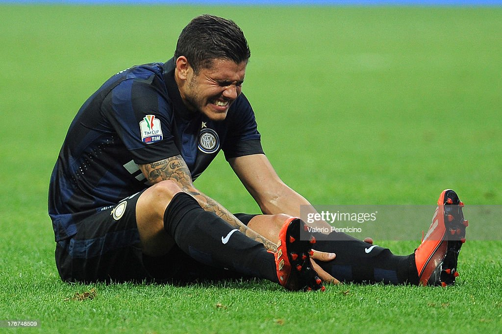 Mauro Icardi of FC Internazionale Milano lies injured on the ground during the TIM cup match between FC Internazionale Milano and AS Cittadella at Stadio Giuseppe Meazza on August 18, 2013 in Milan, Italy.