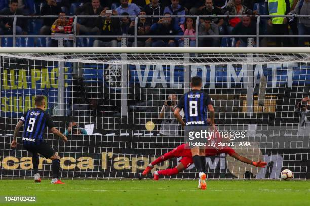 Mauro Icardi of FC Internazionale scores a goal to make it 10 after a VAR decision during the Serie A match between FC Internazionale v ACF...