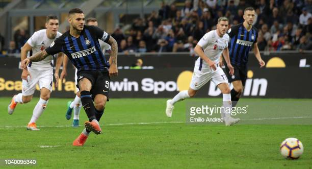 Mauro Icardi of FC Internazionale takes a penalty to score the opening goal during the Serie A match between FC Internazionale and ACF Fiorentina at...