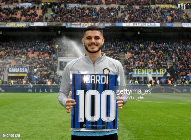 Mauro Icardi of FC Internazionale with his family receives the award for the 100 goal with FC Internazionale during the serie A match between FC...
