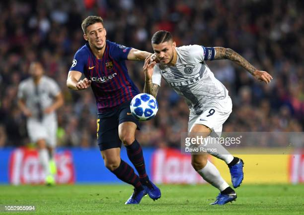 Mauro Icardi of Inter Milan challenges for the ball with Sergio Busquets of Barcelona during the Group B match of the UEFA Champions League between...