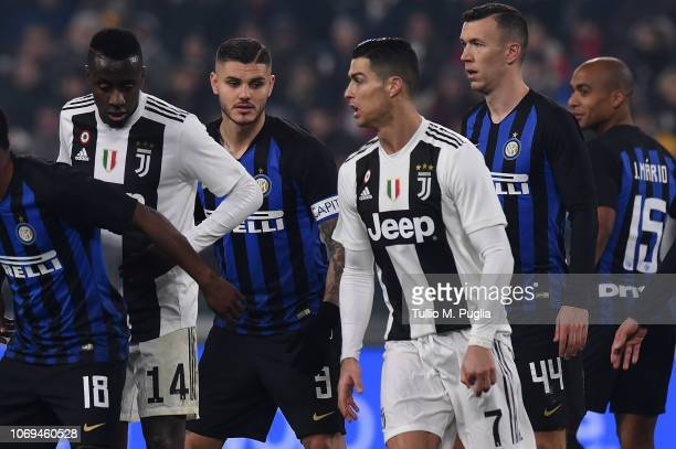 Mauro Icardi of Internazionale and Cristiano Ronaldo of Juventus in action during the Serie A match between Juventus and FC Internazionale at Allianz...