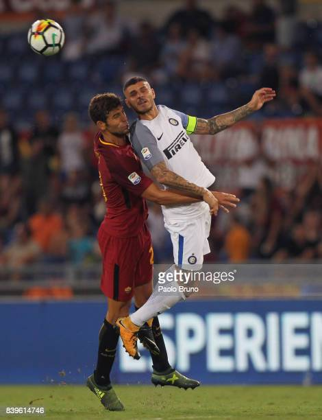 Mauro Icardi of Internazionale competes for the ball wit Federico Fazio of AS Roma during the Serie A match between AS Roma and FC Internazionale on...