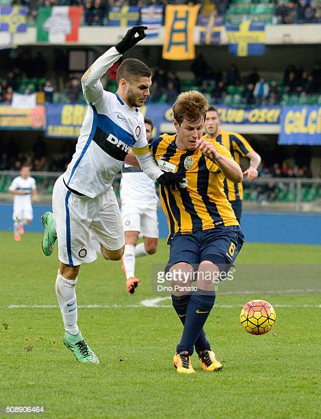 Mauro Icardi of Internazionale Milano competes with Michelangelo Albertazzi of Hellas Verona during the Serie A match between Hellas Verona FC and FC...