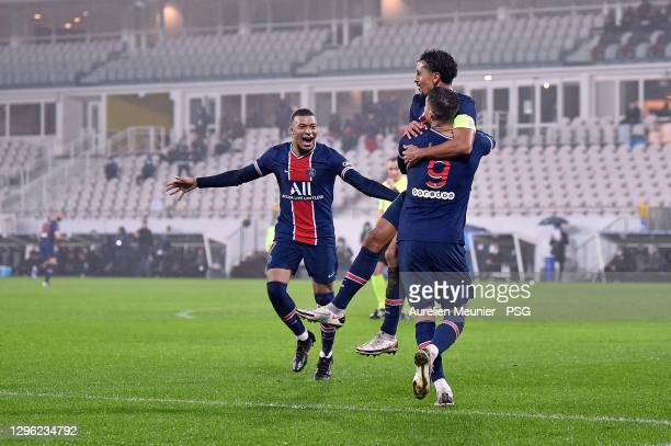 Mauro Icardi of Paris Saint-Germain is congratulated by Kylian Mbappe and Marquinhos after scoring during the Champions Trophy match between Paris...