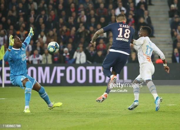 Mauro Icardi of PSG scores his second goal, beating goalkeeper of Marseille Steve Mandanda during the Ligue 1 match between Paris Saint-Germain and...