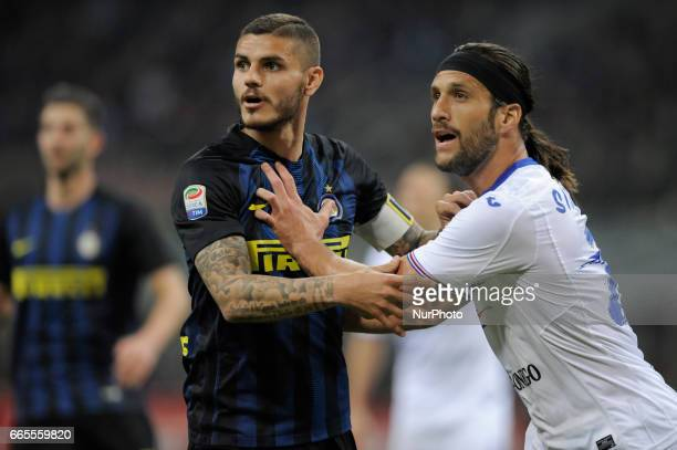 Mauro Icardi vies Maties Silvestre of Sampdoria during the Serie A match between FC Internazionale and UC Sampdoria at Stadio Giuseppe Meazza on...