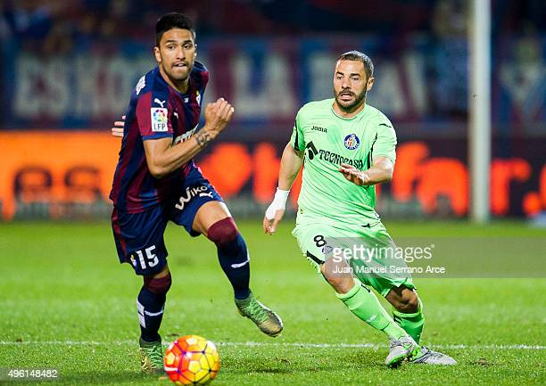 Mauro Javier Dos Santos of SD Eibar duels for the ball with Mehdi Lacen of Getafe CF during the La Liga match between SD Eibar and Getafe CF at...