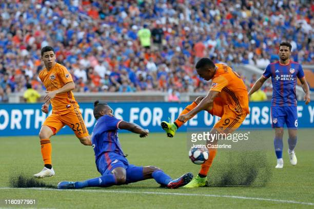 Mauro Manotas of the Houston Dynamo is tackled by Kendall Waston of the FC Cincinnati at Nippert Stadium on July 06, 2019 in Cincinnati, Ohio.