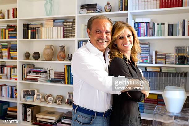 Mauro Masi the executive chief of Consap embraces his girlfriend and Italian TV presenter Ingrid Muccitelli July 15 2011
