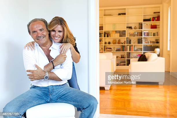 Mauro Masi the italian chief executive of Consap sits on an pouf hugging his girlfriend and Italian TV presenter Ingrid Muccitelli July 15 2011
