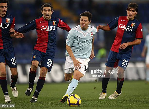 Mauro Matias Zarate of SS Lazio and Giuseppe Biava Ivan Juric and Alberto Zapater of Genoa compete for the ball during the Serie A match between...