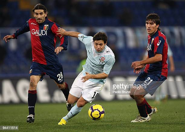 Mauro Matias Zarate of SS Lazio and Ivan Juric and Alberto Zapater of Genoa compete for the ball during the Serie A match between Lazio and Genoa at...