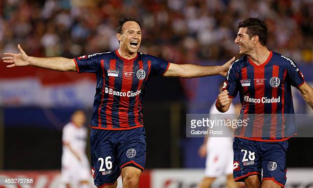 Mauro Matos of San Lorenzo celebrates with Ignacio Piatti after scoring the first goal of his team during a first leg final match between Nacional...