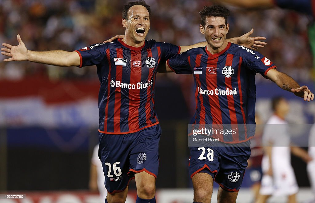 Mauro Matos of San Lorenzo celebrates with Ignacio Piatti after scoring the first goal of his team during a first leg final match between Nacional and San Lorenzo as part of Copa Bridgestone Libertadores 2014 at Defensores del Chaco Stadium on August 6, 2014 in Asuncion, Paraguay.