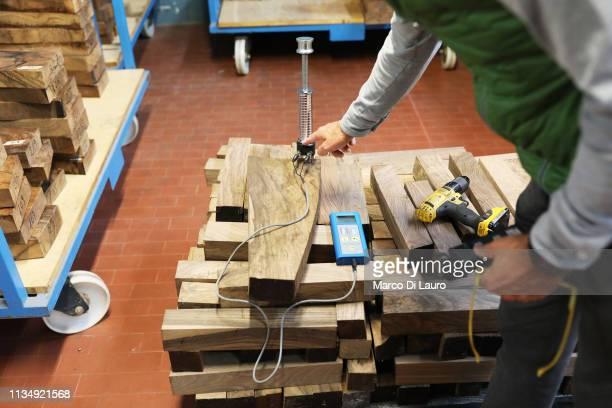Mauro Perazzi checks a piece of wood for a gunshot stock with a moisture probe on April 4 2019 at the Perazzi Armi factory in Botticino Mattina a...