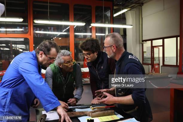 Mauro Perazzi talks to his son Nicola and other technicians about a shotgun on April 4 2019 at the Perazzi Armi factory in Botticino Mattina a...
