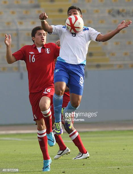 Mauro Portillo of Guatemala controls the ball as he is marked by Aldair Perleche of Peru during the football third place match between Peru and...