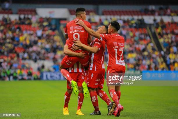Mauro Quiroga of Necaxa celebrates with teammates after scoring the first goal of his team during the 8th round match between America and Neaxa as...