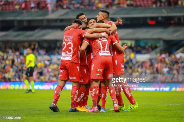 Mauro Quiroga of Necaxa celebrates with teammates after scoring the second goal of his team during the 8th round match between America and Neaxa as...