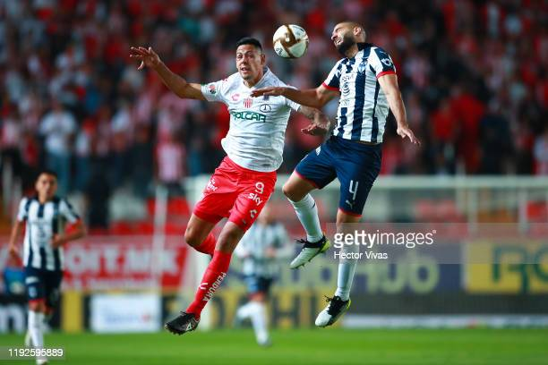 Mauro Quiroga of Necaxa struggles for the ball against Nicolas Sanchez of Monterrey during the Semifinals second leg match between Necaxa and...