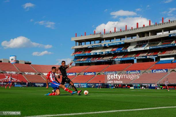 Mauro Quiroga of San Luis fights for the ball William Tesillo of Leon during the 12th round match between Atletico San Luis and Leon as part of the...