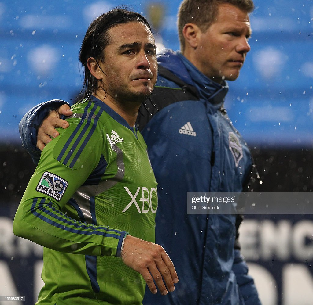 Mauro Rosales #10 (L) and assistant coach David Tenney of the Seattle Sounders FC walk off the pitch after the match against the Los Angeles Galaxy during Leg 2 of the Western Conference Championship at CenturyLink Field on November 18, 2012 in Seattle, Washington. The Galaxy defeated the Sounders 2-1, winning the aggregate playoff 4-2.
