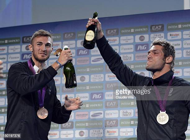 Mauro Sarmiento of Italy bronze medal in the Men's 80kg Taekwondo and Clemente Russo of Italy silver medal in Men's Heavy Boxing celebrate at Casa...
