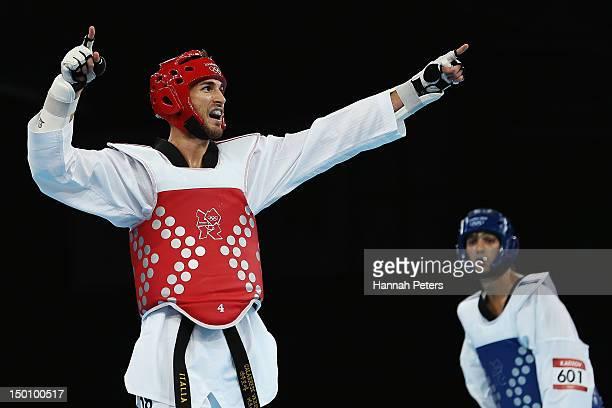 Mauro Sarmiento of Italy celebrates beating Ramin Azizov of Azerbaijan during the Men's 80kg Taekwondo quarterfinal on Day 14 of the London 2012...