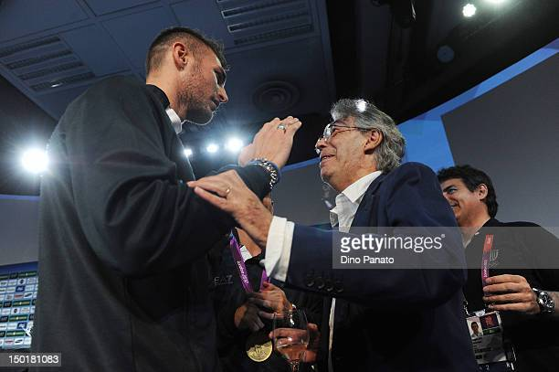 Mauro Sarmiento of Italy celebrates the bronze medal in the Men's 80kg Taekwondo with Massimo Moratti president of football team Internazionale...