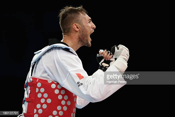 Mauro Sarmiento of Italy celebrates winning the Bronze medal in the Men's 80kg Taekwondo Bronze Medal Finals bout on Day 14 of the London 2012...