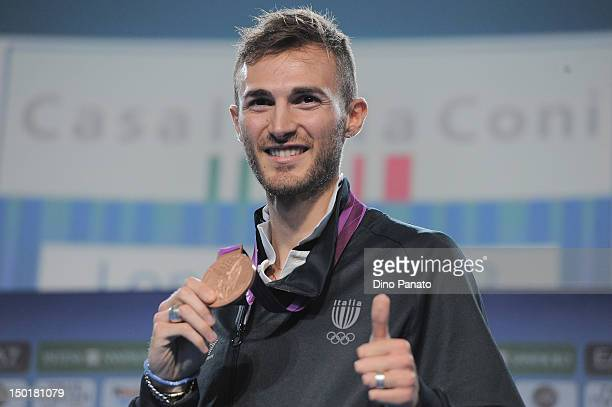 Mauro Sarmiento of Italy poses with the bronze medal in the Men's 80kg Taekwondo at Casa Italia during London 2012 Olympic Games at The Queen...