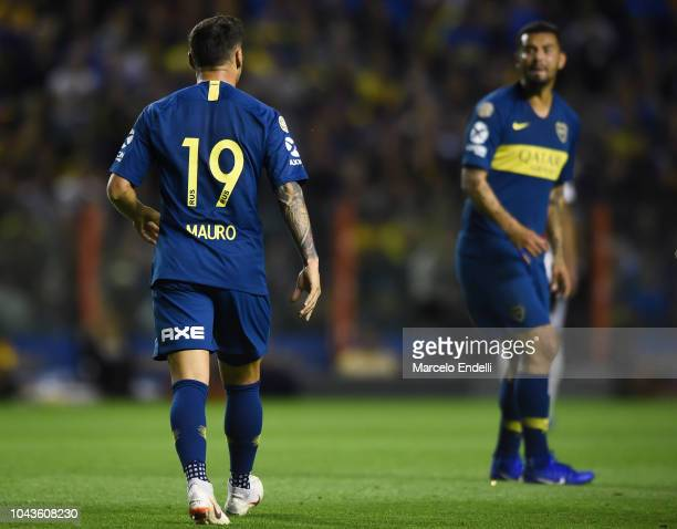 Mauro Zarate argues with teammate Edwin Cardona of Boca Juniors during a match between Boca Juniors and River Plate as part of Superliga 2018/19 at...