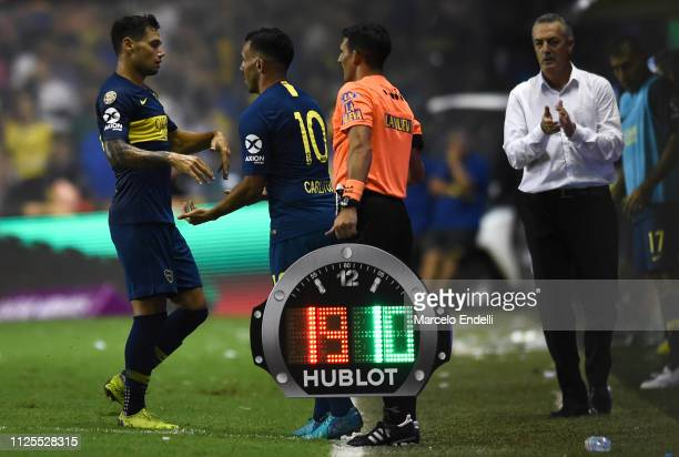 Mauro Zarate leaves the field replaced by teammate Carlos Tevez of Boca Juniors during a match between Boca Juniors and Lanus as part of Superliga...
