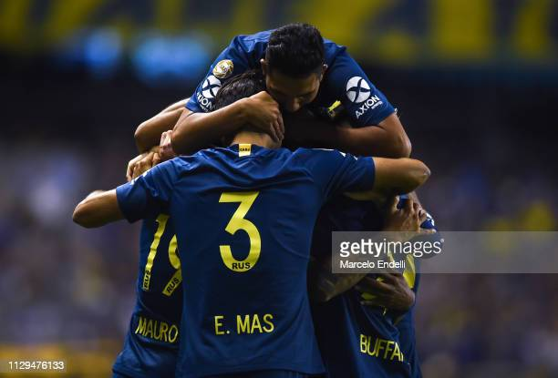 Mauro Zarate of Boca Juniors celebrates after scoring the first goal of his team with teammates during a match between Boca Juniors and San Lorenzo...